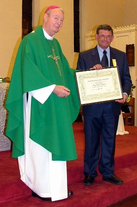 David Goodhind and Bishop Henderson holding the Bene Merenti Certificate